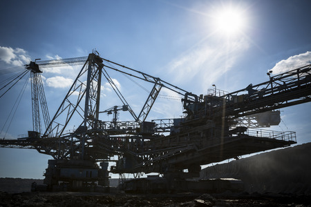 a huge working dredge in a mine, silhouette photo