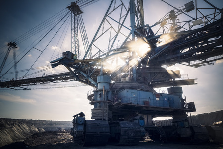 a huge working dredge in a mine photo