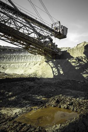 a huge working dredge in a mine photo