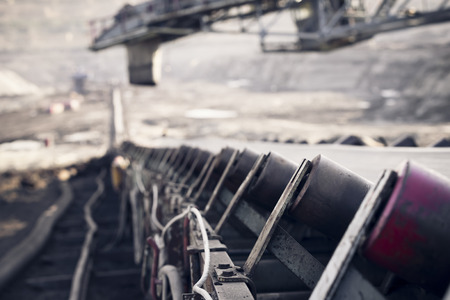 the trundles of a conveyor belt nearly a coal in a mine photo