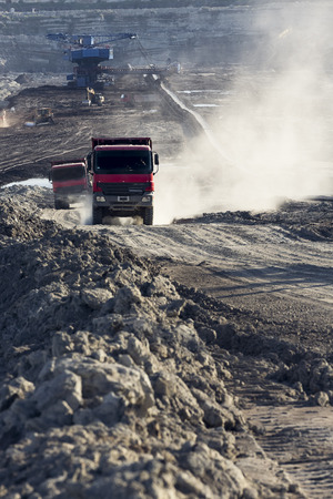 trucks operating in a coal mine at work Stock Photo