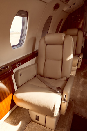 a luxury aircraft interior, leather seats, black and white photo