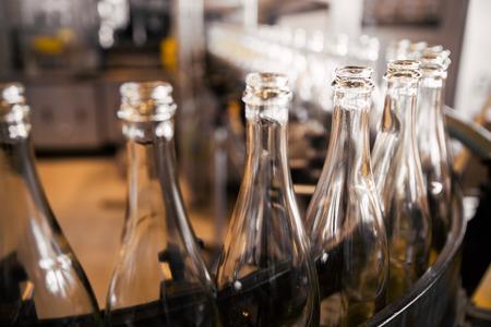 conveyors: empty liquor bottles on the conveyor belt Stock Photo