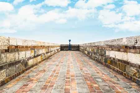 pay wall: Views of a European city, old brick wall