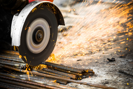 tool and die: Electrical steel grinding wheel on a construction site Stock Photo