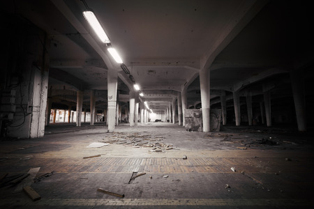 abandoned warehouse: industrial interior of an abandoned factory building
