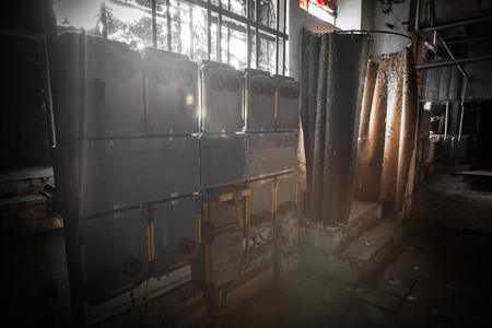iron curtains: electrical switchboard in an abandoned factory building