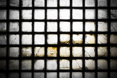 glass brick: glass brick wall of an abandoned factory building, poor light Stock Photo