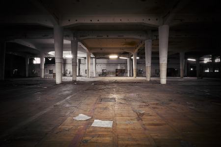 inside of: industrial interior of an abandoned factory building