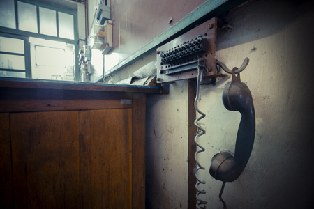 poor light: old landline phone in an abandoned factory, poor light