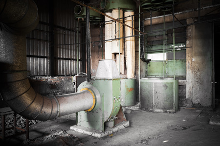air cleaner: air cleaner machine in an abandoned factory building, poor light