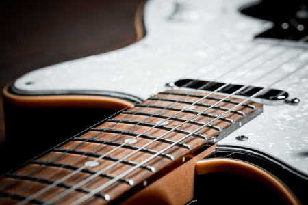 poor light: an electric guitar details, close up, poor light