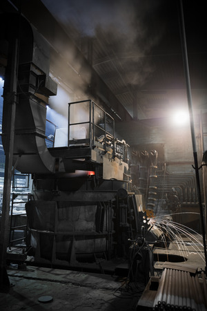 foundry: furnace operating a foundry, poor light