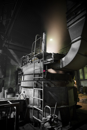 poor light: furnace operating a foundry, poor light