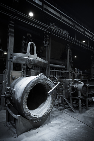 empty tank: a foundry furnace with an empty tank, poor light Editorial