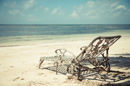 old, rusty deck chairs on the beach