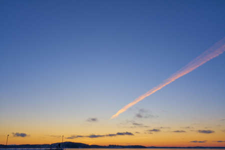 A trail from the plane in the sunset sky. Copy space. Stock fotó - 162663479