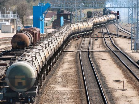 Locomotive of tanks with oil and fuel transport by rail photo