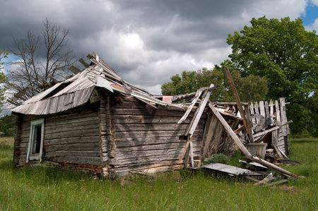 negligence: Old abandoned house falling down in the middle of grassfield  Stock Photo