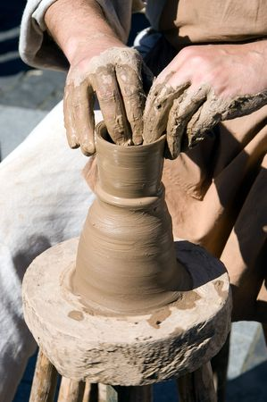 Human hands working with a pottery wheel Stock Photo - 5419260