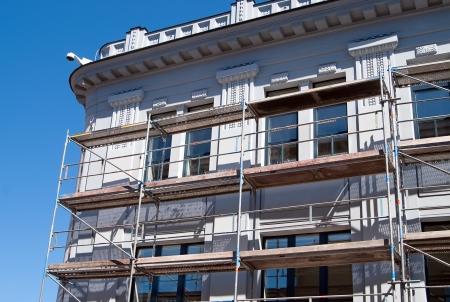 blue facades sky: The scaffolding near a facade of a building for restoration
