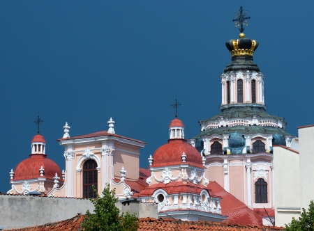 casimir: The Jesuit Church of Saint Casimir towers in Vilnius, Lithuania  with blue sky background