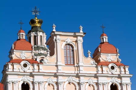 casimir: The top part of the Roman Catholic Church of St Casimir in Vilnius against the blue sky