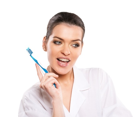 attractive woman with tootbrush photo