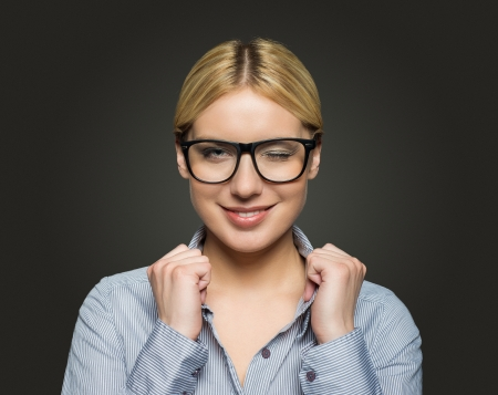 attractive businesswoman with glasses on dark background photo