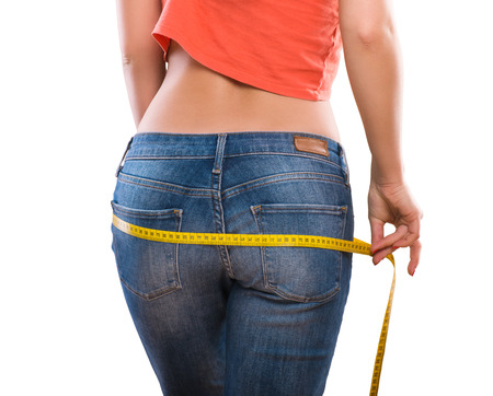 Weight losing - measuring woman photo