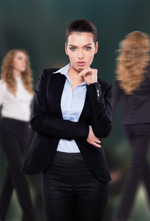 business attire teacher: Beautiful businesswoman looking at you Stock Photo