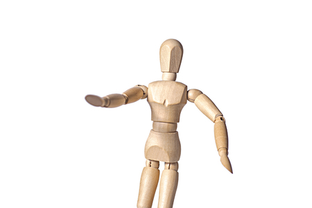 A wooden mannequin is reaching with one hand in a stoping gesture, isolated on white background Stockfoto