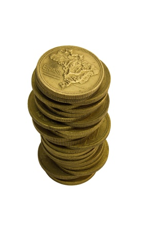 Pile of old Brazilian coins in gold color photo