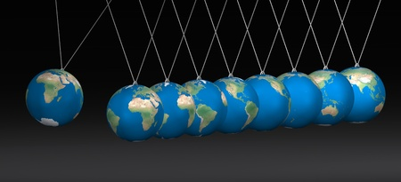Newton cradle balancing with earth balls over black photo