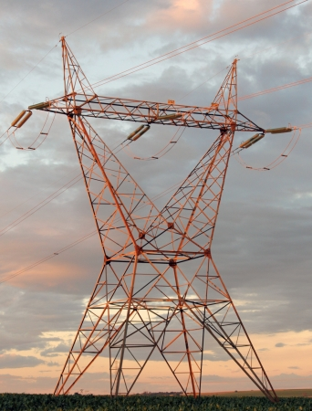 Eletricity tower providing energy distribution over sunset photo