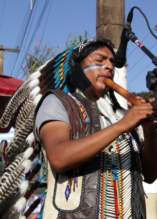 MARACAI, SAO PAULO BRAZIL - AUGUST 26  An unidentified peruvian indian musician at the annual religious pilgrimage of  Menino da Tabua  festival that attracts 15 000 visitors by year on August 26, 2012 in Maracai, Sao Paulo, Brazil