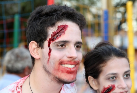 gruesome: ASSIS, SAO PAULO BRAZIL - SEPTEMBER 29  An unidentified man dressed as a zombie, during the annual zombie walk on September 29, 2012 in Assis, Sao Paulo, Brazil