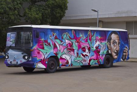 grafiti: SAO PAULO, BRAZIL - FEBRUARY 01, 2015: A bus painted with grafiti art design exposed in the Ibirapuera Park at Sao Paulo Brazil. Editorial