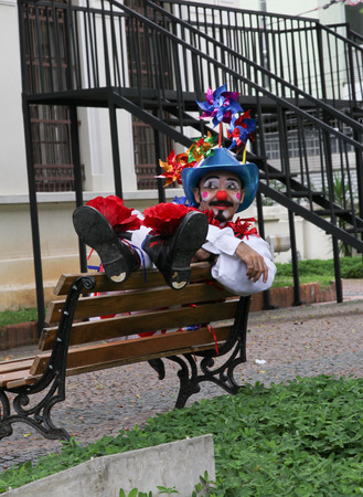 buffoon: SAO PAULO, BRAZIL - MARCH 8, 2015: An unidentified funny clown with typical costumes on the streets of Sao Paulo Brazil.