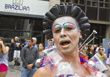 gay parade: SAO PAULO, BRAZIL - June 7, 2015: An unidentified Drag Queen dressed in traditional costume celebrating lesbian, gay, bisexual, and transgender culture in the 19º Pride Parade Sao Paulo. Editorial