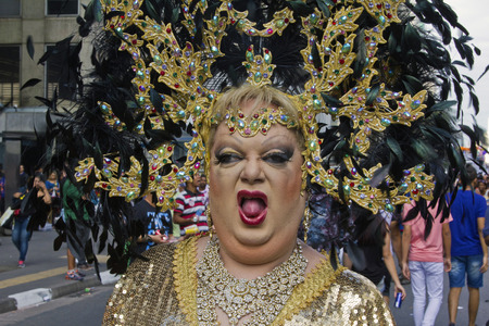 lesbian: SAO PAULO, BRAZIL - June 7, 2015: An unidentified Drag Queen dressed in traditional costume celebrating lesbian, gay, bisexual, and transgender culture in the 19º Pride Parade Sao Paulo.