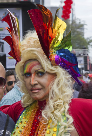 transgender: SAO PAULO, BRAZIL - June 7, 2015: An unidentified Drag Queen dressed in traditional costume celebrating lesbian, gay, bisexual, and transgender culture in the 19º Pride Parade Sao Paulo.