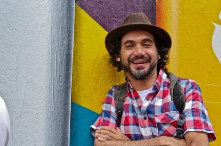 Sao Paulo, Brazil July 18, 2015: Graffiti artist Eduardo Kobra posing in front of his mural about recycling in Sao Paulo Brazil. Editorial