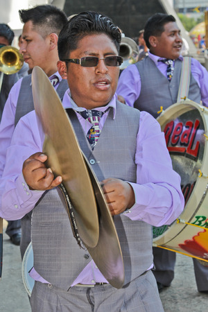 show folk: SAO PAULO, BRAZIL August 9 2015: An unidentified man with typical costumes playing a typical music instrument during the Morenada parade in Bolivian Independence Day celebration in Sao Paulo Brazil.