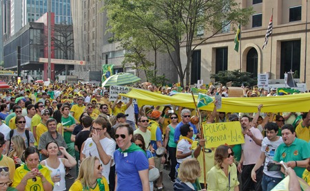 federal government: SAO PAULO, BRAZIL August 16 2015: An unidentified group of people with flags and yellow and green clothes in the protest against federal government corruption in Sao Paulo Brazil.