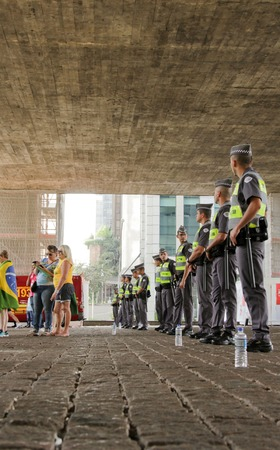 federal government: SAO PAULO, BRAZIL August 16, 2015: An unidentified group of cops take care of security in the protest against federal government corruption in Sao Paulo Brazil.