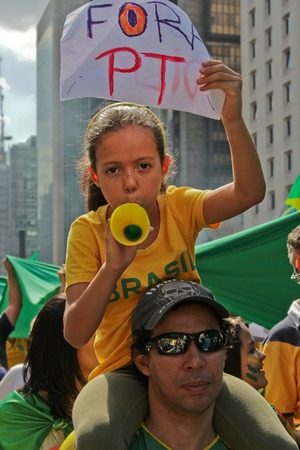federal government: SAO PAULO, BRAZIL August 16, 2015: An unidentified man with a girl with a poster in the protest against federal government corruption in Sao Paulo Brazil. Editorial