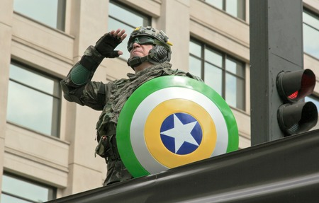problematic: SAO PAULO, BRAZIL August 16, 2015: An unidentified man dressed as a super hero with colors yellow and green in the protest against federal government corruption in Sao Paulo Brazil. Editorial