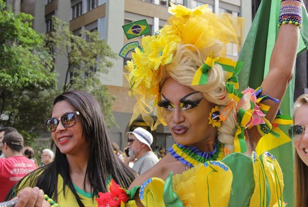federal government: SAO PAULO, BRAZIL August 16, 2015: A drag queen called Charlene Blue with yellow and green costume poses for pictures and selfies in the protest against federal government corruption in Sao Paulo Brazil. Editorial