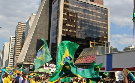 problematic: SAO PAULO, BRAZIL August 16 2015: An unidentified group of people with flags and yellow and green clothes in the protest against federal government corruption in Sao Paulo Brazil.